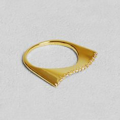 Petit Sesame | Gold-plated alizée ring | Designed by Petit sesame | $12.00 | 18k gold plated full brass wake ring set with cubic zirconia