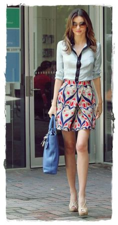 #Miranda #Kerr Street Style Snapshot - Adorably Chic |  Miranda Kerr stepped out in fabulous Prada Resort 2010 ensemble this week.  She looked adorably chic in the navy-accented button-down, print skirt, nude sandals, and bright blue bag.  The Victoria's Secret model wore this to renew her driver's license in Sydney – ah the life of the chic and fabulous.
