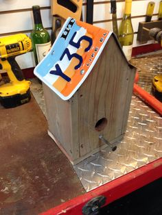 https://www.etsy.com/listing/177734860/bird-house-made-from-recycled-meterials