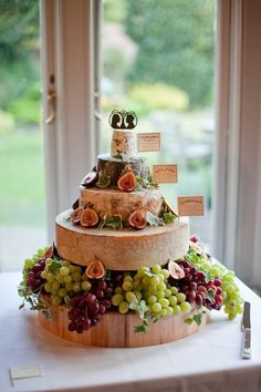 "A wedding Cheese Wheel Cake? A ""cake"" of cheese wheels topped with perfect silhouettes of the bride and groom. Buffet Dessert, Deco Buffet, Alternative Wedding Cakes, Wedding Cake Alternatives, Martha Stewart Weddings, Bolo Diy, Cheese Tower, Wheel Cake, Cheese Table"