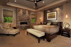 The stacked stone wall with a complementary fireplace in the middle  is a genius idea for creating a modern bedroom with comfy and cozy ambiance. Description from rilane.com. I searched for this on bing.com/images