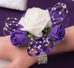 Bridesmaid wrist corsage. Foam flowers. Diamanté wrist strap. Cadbury purple and white roses