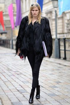 Model Yulia Terentieva rocks a dramatic look with help from her glam fur jacket.    - ELLE.com