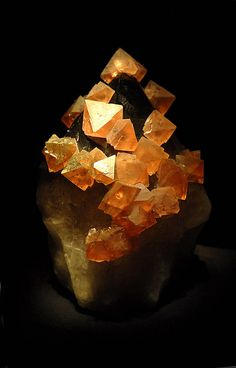 Orange Fluorite or fluorspar is an isometric mineral composed of calcium fluoride. - Photolitherland, Wikipedia Commons
