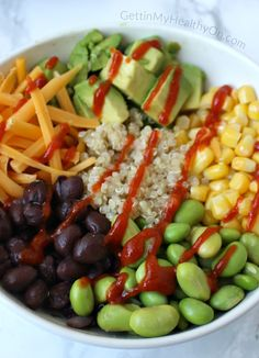 For a healthy lunch idea to meal prep, try this Quinoa Protein Bowl made with edamame, black beans, corn, and avocado.