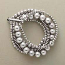 This multi-strand sterling silver beads bracelet is both simple and simply striking.