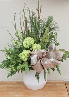 Indoor evergreen arrangement for the Christmas season.