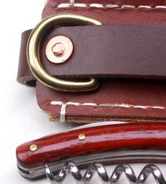 Corkscrew and leather sheath
