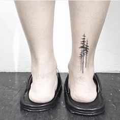 Simple + stunning evergreen tattoo.