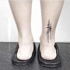 Simple + stunning evergreen tattoo.