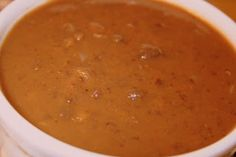 Pumpkin Black Bean Soup 1 tablespoon extra-virgin olive oil 1 cup chopped onions 2 cloves garlic, minced 4 cups water or Vegetable Broth 3 (15.5-ounce) cans black beans, rinsed and drained 1 (14.5-ounce) can diced tomatoes 1 (15-ounce) can pumpkin 1 1/2 teaspoon cumin 1 1/2 teaspoon salt 1/8 teaspoon Spicy Pumpkin