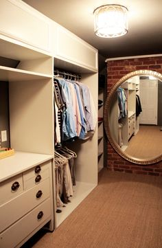 Master closet renovation with before and after pictures--wow.  nice to have a light in there