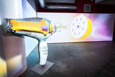 Shiraz Events recently produced a launch party for Conair's new 3Q hair dryer. Held in a Tesla showroom in New York's Chelsea neighborhood, the event featured an oversize sculpture of the hair dryer. The sculpture was custom fit with video projections that displayed hologram-like images of the 3Q's inner workings and brush-less motor.  Photo: Courtesy of Shiraz Events