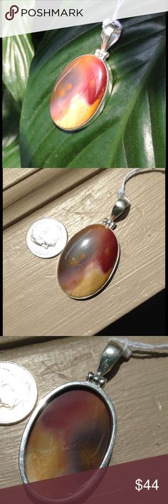 Fabulous Swirling Brown Mookaite Pendant Beautiful large, oval-cut, genuine brown Mookaite stone pendant. Polished to a brilliant shine and set in 925 sterling silver. New! Boutique Jewelry Necklaces