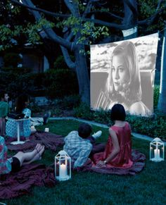 Watching a movie outside is fun for the whole family. | http://domino.com
