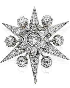 A Victorian diamond star brooch/pendant The six-ray star set throughout with old round brilliant-cut diamonds with similarly-cut diamond accents to knife-wire spokes between each, width 44mm, pendant fitting deficient, drop hook present, the diamonds estimated to weigh approximately 4.38cts in total