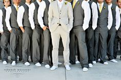 Groom and groomsmen in different shades of grey but with blush pink/champange ties