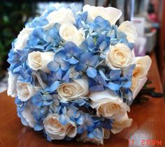 Bridal Bouquet Baby Blue Hydrangeas & Ivory Roses This might be it. Hydrangea Bouquet Wedding, Bridal Bouquet Blue, Blue Bridal, Bride Bouquets, Rose Bouquet, Bridesmaid Bouquet, Wedding Flowers, Blue Hydrangea, Purple Tulips