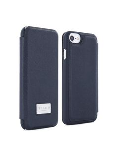 Ted Baker Airies Men's Folio Case for iPhone 6/7 - Navy Be well equipped for everyday missions with AIRIES, Ted Baker's signature folio case revamped in a statement AW16 style. Sporting one of three statement shades in a distinguished leather effect, these cases are a practical piece to grab-and-dash at the drop of a hat. With intriguing textures, crisp lines and immaculate tailoring, AIRIES in navy, oxblood or grey herringbone will be all the cover you need.Depth: 10 MMHeight: 1...
