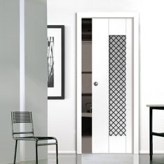 Single Pocket Symmetry Axis White Door sliding door system in three size widths with Monochrome Opaque Chequered Glass. #modernpocketdoor #contemporarypocketdoor #pocketdoor