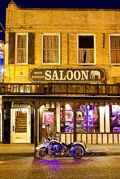 Bike outside a bar in Fort Worth Stockyards at night, Texas, United States of…