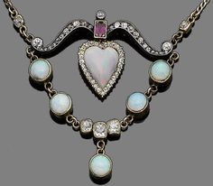 An opal, ruby and diamond necklace.  The bow-shaped frame set with old brilliant-cut diamonds and an oval-cut ruby, suspending a heart-shaped opal within a surround of similarly-cut diamonds, and a swag of circular cabochon opals and cushion-shaped diamonds, to a later fancy-link chain, diamonds approx. 0.95ct total, composite, length 44.0cm