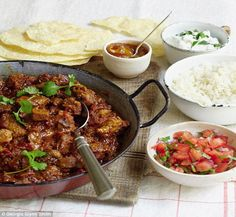 Lamb dhansak with fresh tomato relish and raita