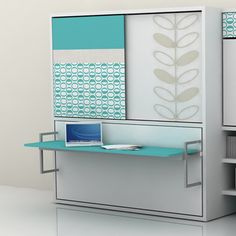 This closet/desk folds out to a bed. You can even leave all your stuff on the desk because it stays flat. WANT!!