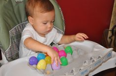 I started this activity with J at 13 months.  I gave him a bowl of plastic eggs and the empty egg carton and let him try to fill each space.  He loved it.  It was a great motor skills activity.  Ev…