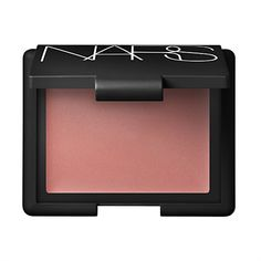 "NARS cream blush in penny lane: ""I put this on the apples of my cheeks and blend outward for a little extra color. It's the perfect shade of nude for a 'barely there' look."""