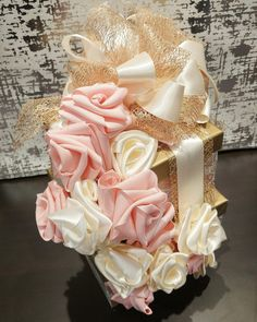 Hand made ribbon roses adorn this stunning centrepiece perfect for a wedding head table Wedding 2017, Our Wedding, Wedding Ideas, Wedding Gift Wrapping, Wedding Gifts, Head Table Wedding, Professional Gifts, Wedding Calligraphy, Wedding Season
