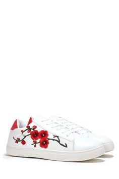 Dress for the weather. The In Bloom Sneaker features a round toe, lace-up closure, contrast padded heel collar, and embroidered floral appliqués at side.
