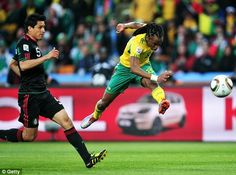 Siphiwe Tshabalala of South Africa scores the first goal during the 2010 FIFA World Cup South Africa Group A match between South Africa and Mexico at Soccer City Stadium on June 2010 in Johannesburg, South Africa. Soccer Players, Football Soccer, Soccer City, Best Player, Fifa World Cup, South Africa, How To Memorize Things, Challenges, Exercise