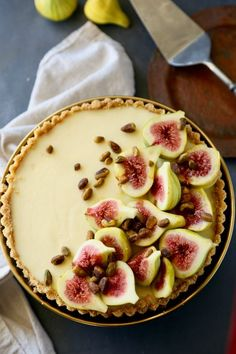 Stunning no bake mascarpone tart topped with fresh tiger figs, honey, and pistachios
