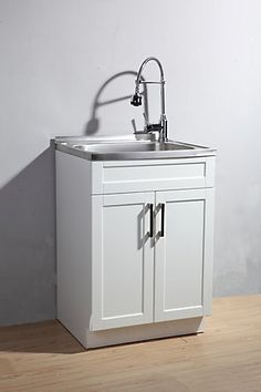 This Utility Laundry Sink with Cabinet includes a fully-assembled vanity with stainless steel sink, faucet with dual action spray plus a complete plumbing kit for easy installation. The attractive shaker style cabinet with brushed nickel hardware provides ample storage space for your laundry supplies. The stainless steel sink has a generous depth to accommodate a variety of laundry room/clean-up tasks.