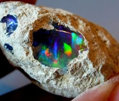 GEODE Opal Geode - A peek into another universe. Amazing what is inside an ordinary looking rock!