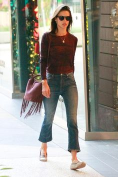Alessandra Ambrosio wearing Jacquie Aiche Bone Double Horn Cuff, Kenneth Cole Small Foldover Crossbody Bag in Bordeaux and Mother Insider Crop Jeans in Double Trouble