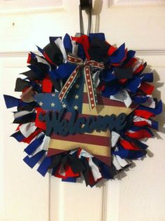 """Pinner says, """"Get a metal wreath form, tie the strips of fabric around the circle. I got the """"welcome"""" star from Hobby Lobby, and that was it!"""" We love this patriotic wreath and think it would be perfect for any 4th of July decor! Patriotic Crafts, Patriotic Wreath, Patriotic Decorations, 4th Of July Wreath, Fabric Wreath, Diy Wreath, Mesh Wreaths, Wreath Forms, Fourth Of July"""