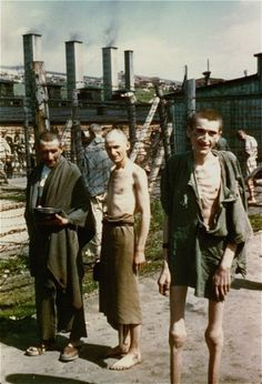 """Survivors in the """"Russian Camp"""" section of Mauthausen."""