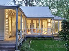 weatherboard + verandah + large windows