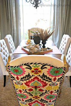 A clever DIY refurb of upholstered chairs for a fun but elegant dining room.
