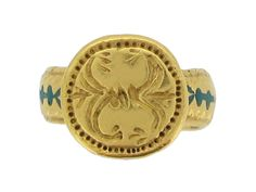 Ancient Byzantine gold and enamel ring, circa 8th - 10th century AD. A heavy solid gold ring ornately decorated with an engraved foliate pattern with bold ...