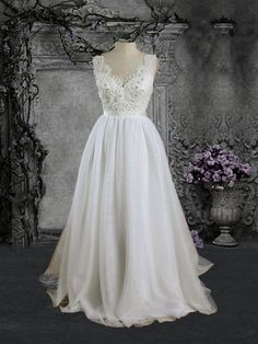 Beautiful soft tulle wedding dress with lace bodice and a stunning low open back. Processing Time Standard processing time is approx 6 - 8 weeks, peak season may be longer. If you need rush service, p
