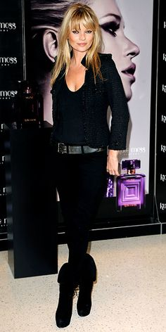 Kate Moss  WHAT SHE WORE  Moss launched her latest fragrance, Vintage Muse, in a London Boots drugstore in a tweed jacket layered over black skinny jeans and suede boots.