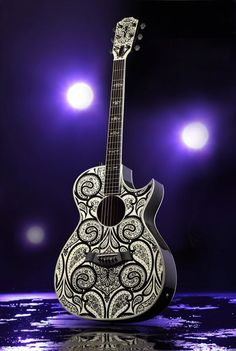 Dang, that's pretty! Custom Taylor #Guitar... one day :) http://ozmusicreviews.com/christmas-gifts-for-guitarists