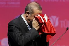 President Tayyip Erdogan kisses a handmade Turkish flag