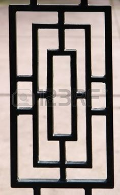 black, near silhouette, of a portion of a deco designed wrought iron gate Stock Photo Home Window Grill Design, Grill Gate Design, Steel Gate Design, Front Gate Design, House Gate Design, Door Gate Design, Railing Design, Modern Window Design, Iron Window Grill