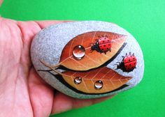 Painted stone ladybugs on leafs Is Painted by KanetisStones