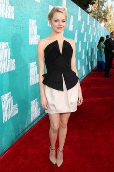 The gorgeous Emma Stone in a chic Martin Grant dress at the 2012 MTV Movie Awards.