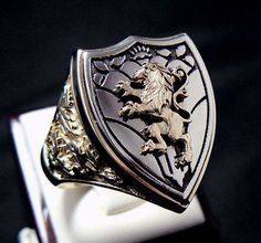 http://www.ebay.com/itm/ANTIQUE-ROYAL-LION-KNIGHT-CREST-14K-GOLD-MENS-RING-/220679177849 $2,350